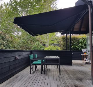 retractable awning over wood deck