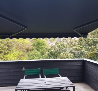 retractable awning over wood deck 2
