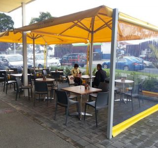 Columbus Crank Screen clear PVC Commercial Cafe 320x300 - Roller Blinds / Outdoor Curtains - Ziptrak®