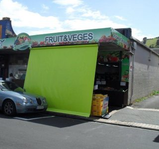 Crank Screen Green PVC Commmercial Devonport Fruit Vegies 320x300 - Roller Blinds / Outdoor Curtains - Ziptrak®