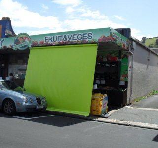 Crank Screen Green PVC Commmercial Devonport Fruit Vegies 320x300 - Crank Screens / Roller Blinds / Outdoor Curtains