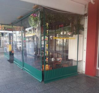 Crank Screens clear PVC Commercial Lebanese Cafe 320x300 - Roller Blinds / Outdoor Curtains - Ziptrak®