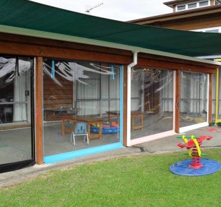 Hand Rolled Screens clear PVC Commercial Te Kohanga Reo Manurewa 320x300 - Crank Screens / Roller Blinds / Outdoor Curtains