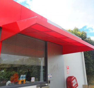 Wedge Awning Commercial caltex 320x300 - Fixed Frame PVC Canopies (Tensioned Membrane Structure)
