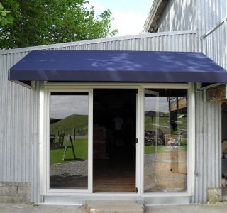 Wedge Awning Residential 9 320x300 - Fixed Frame PVC Canopies (Tensioned Membrane Structure)