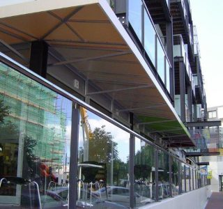 Wedge Awning commercial 3 320x300 - Fixed Frame PVC Canopies (Tensioned Membrane Structure)