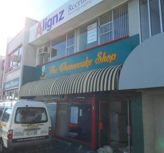 Wedge Awning commercial retail 320x300 - Fixed Frame PVC Canopies (Tensioned Membrane Structure)