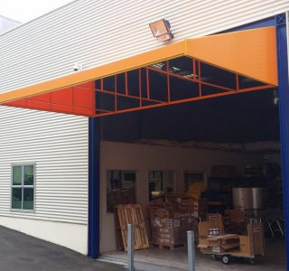 Wedge awning commercial Pharmacy Direct 2 320x300 - Fixed Frame PVC Canopies (Tensioned Membrane Structure)