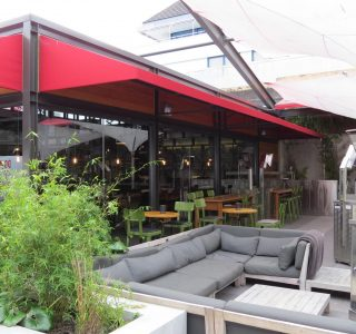 wedge awning commercial restaurant outdoor dining 320x300 - Fixed Frame PVC Canopies (Tensioned Membrane Structure)